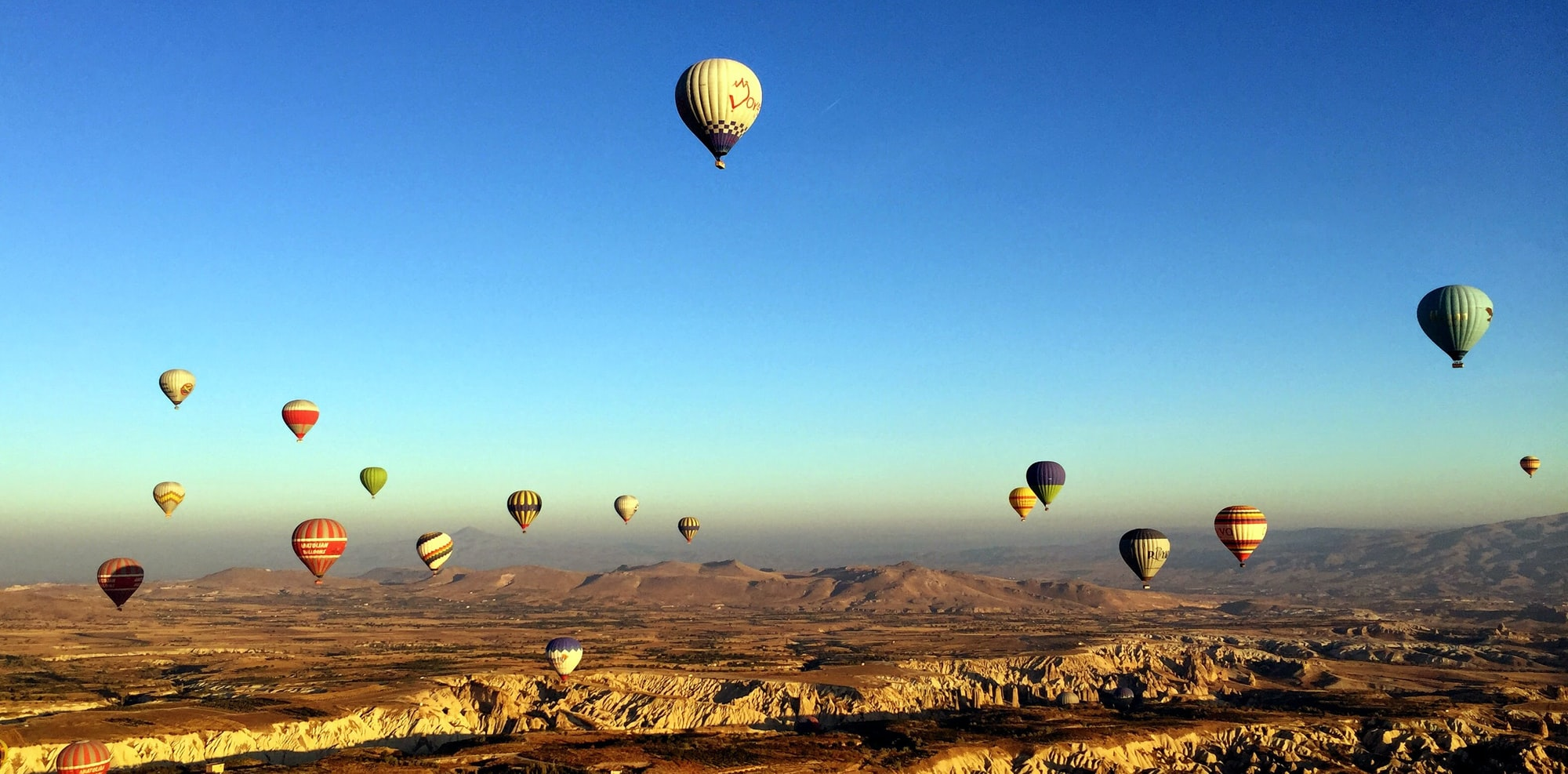 Hot air ballooning in the national park of Cappadocia. Every morning a hundred or more balloons lift off at sunrise, sailing over the remarkable landscapes of central Turkey.