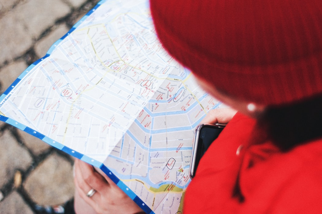 person searching on a map