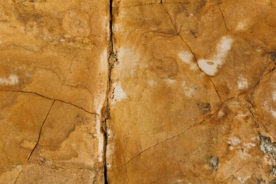 brown cracked wall stone teams background