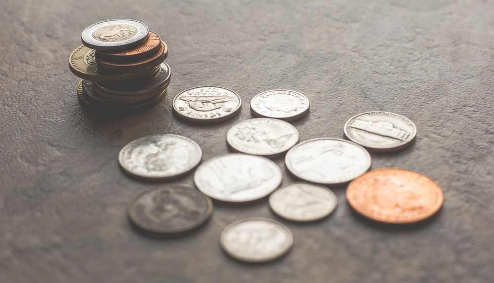 coins on gray surface
