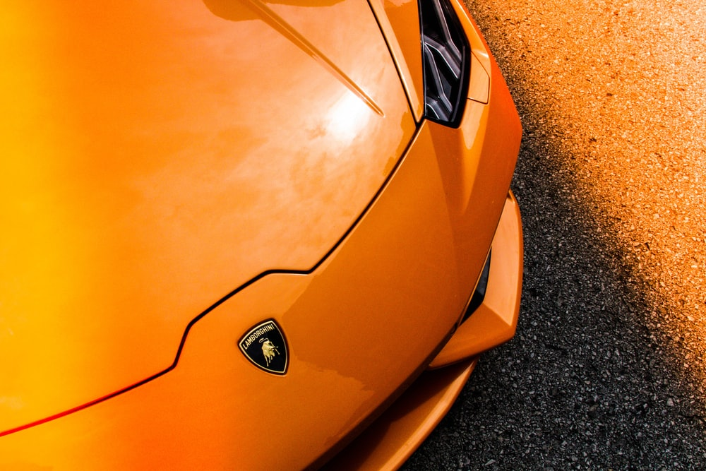 orange Lamborghini vehicle closeup photography
