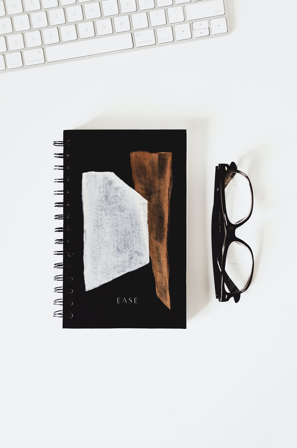 eyeglasses beside Ease book