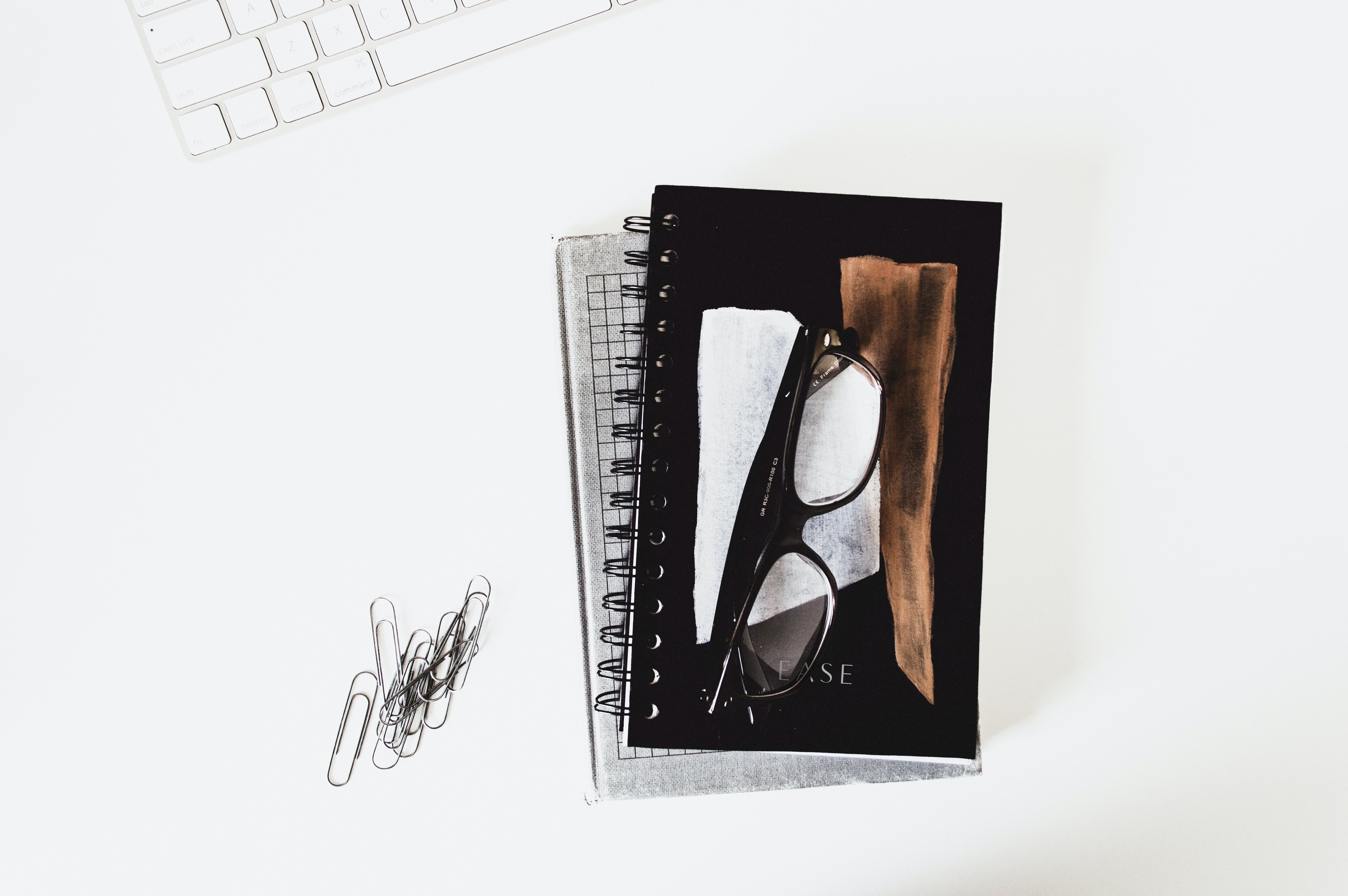 eyeglasses with black frames on book
