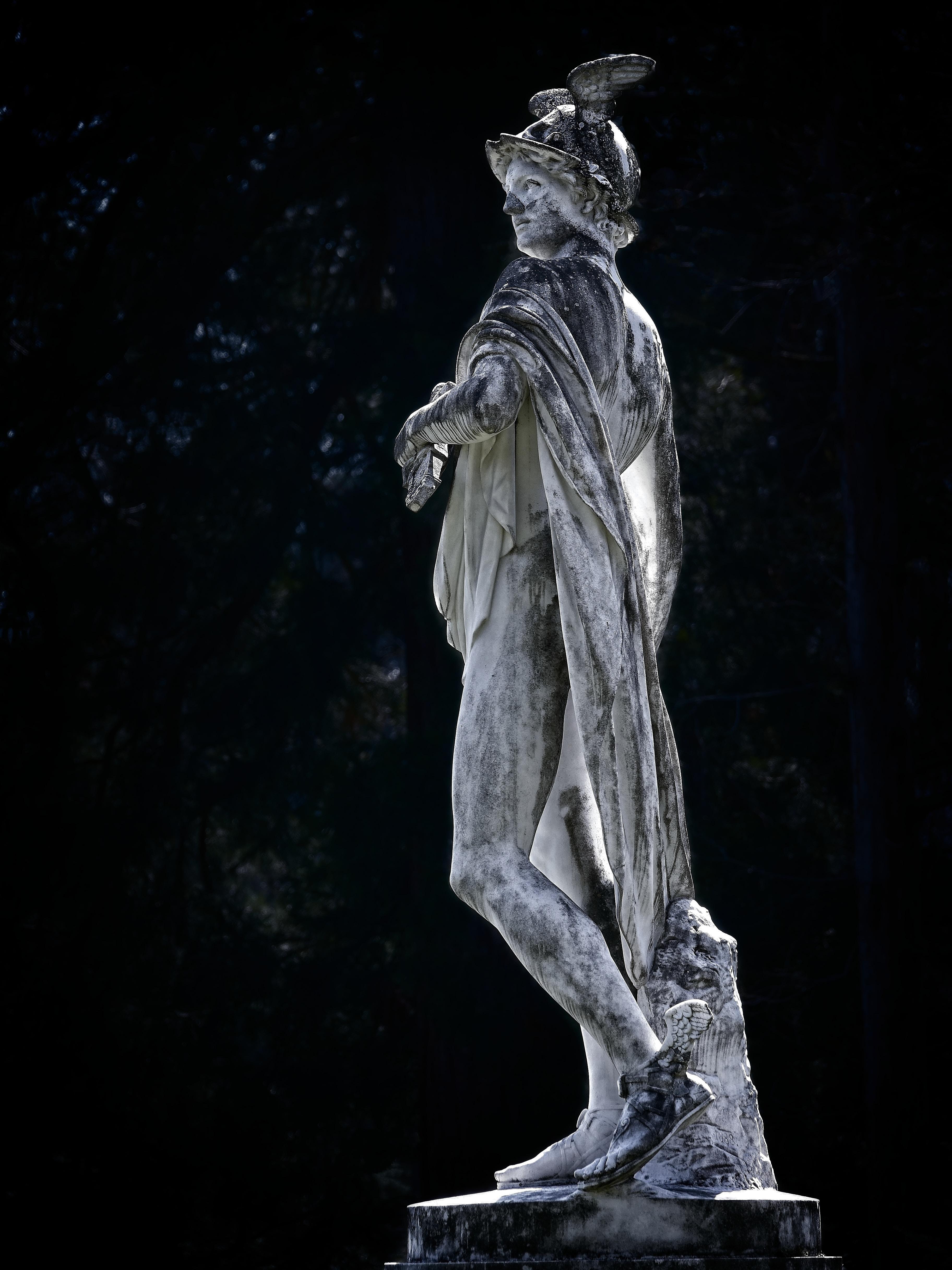 gray man concrete statue