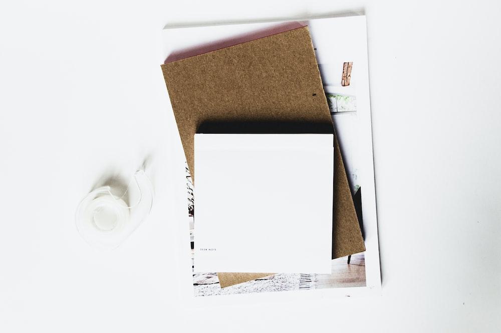white printer paper on corkboard