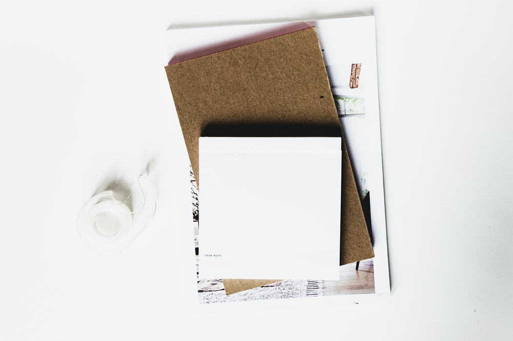 white printer paper on corkboard