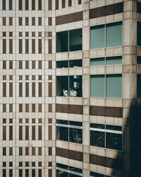 three persons at building window