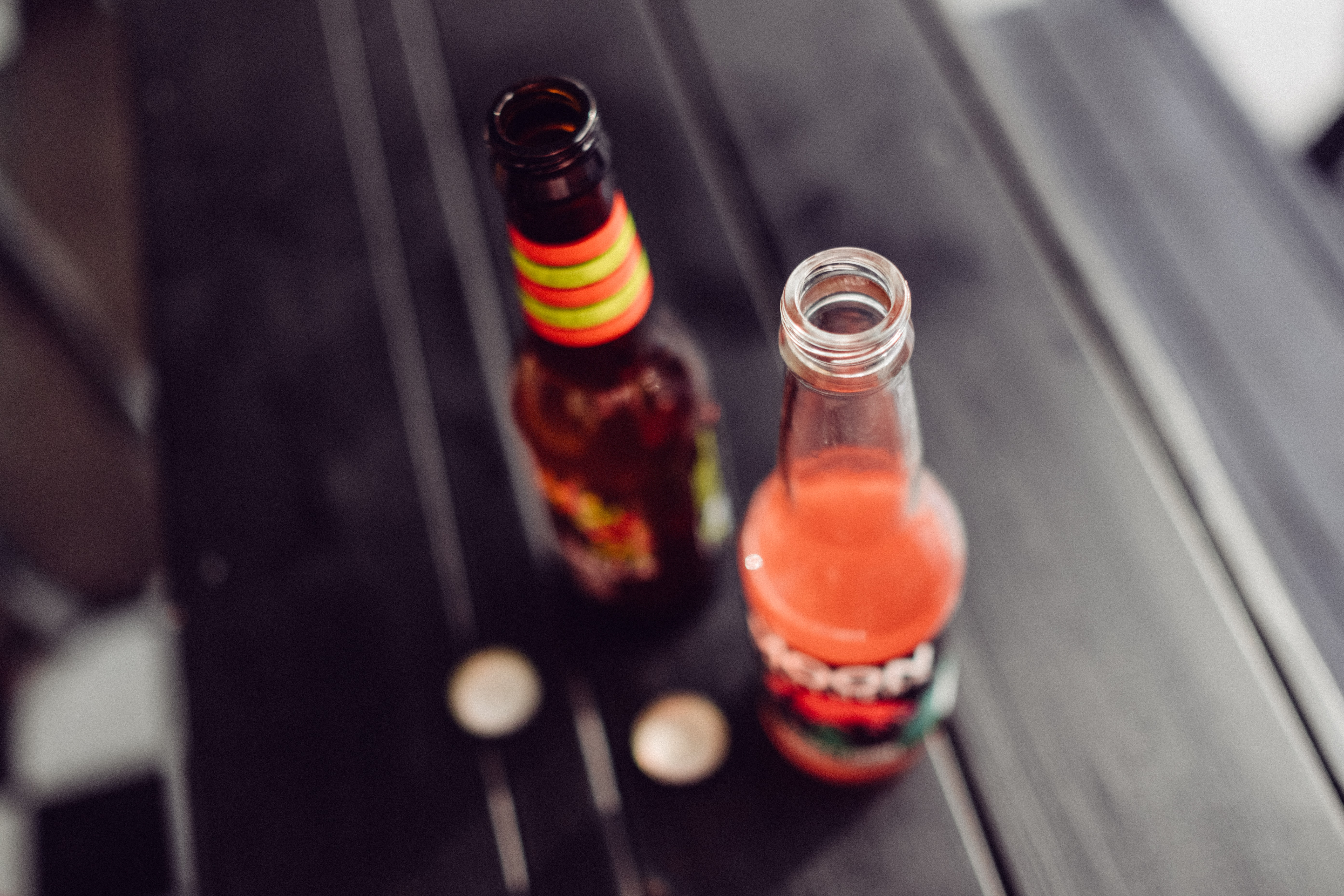 selective focus photography of two glass bottles