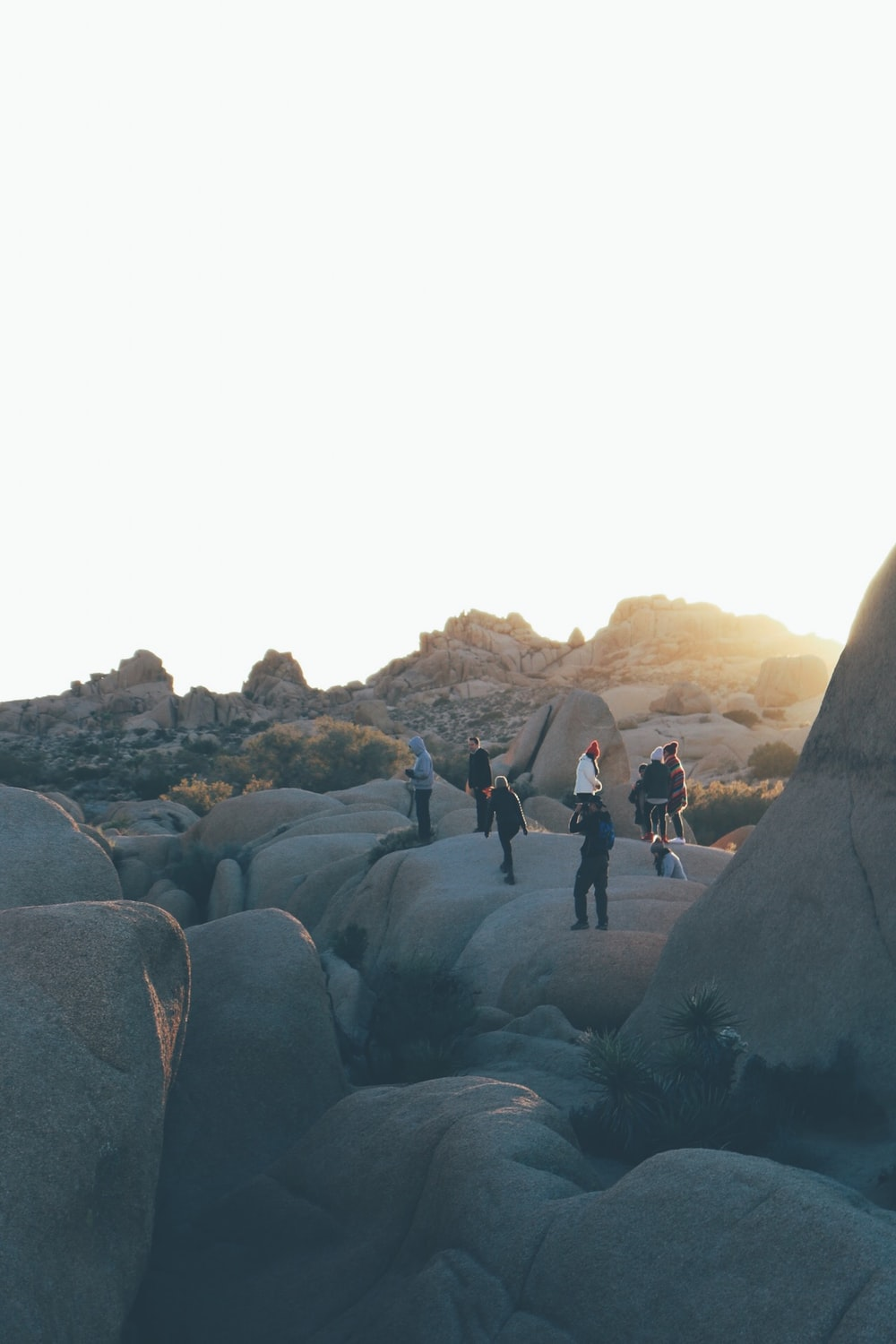 people standing on rock formations during daytime