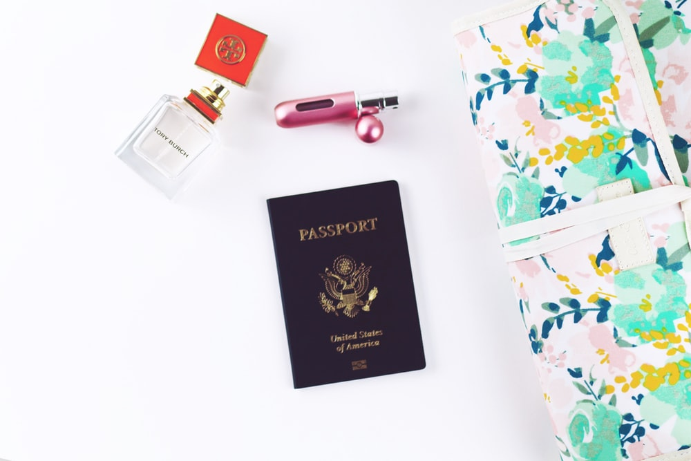 passport on top of white surface