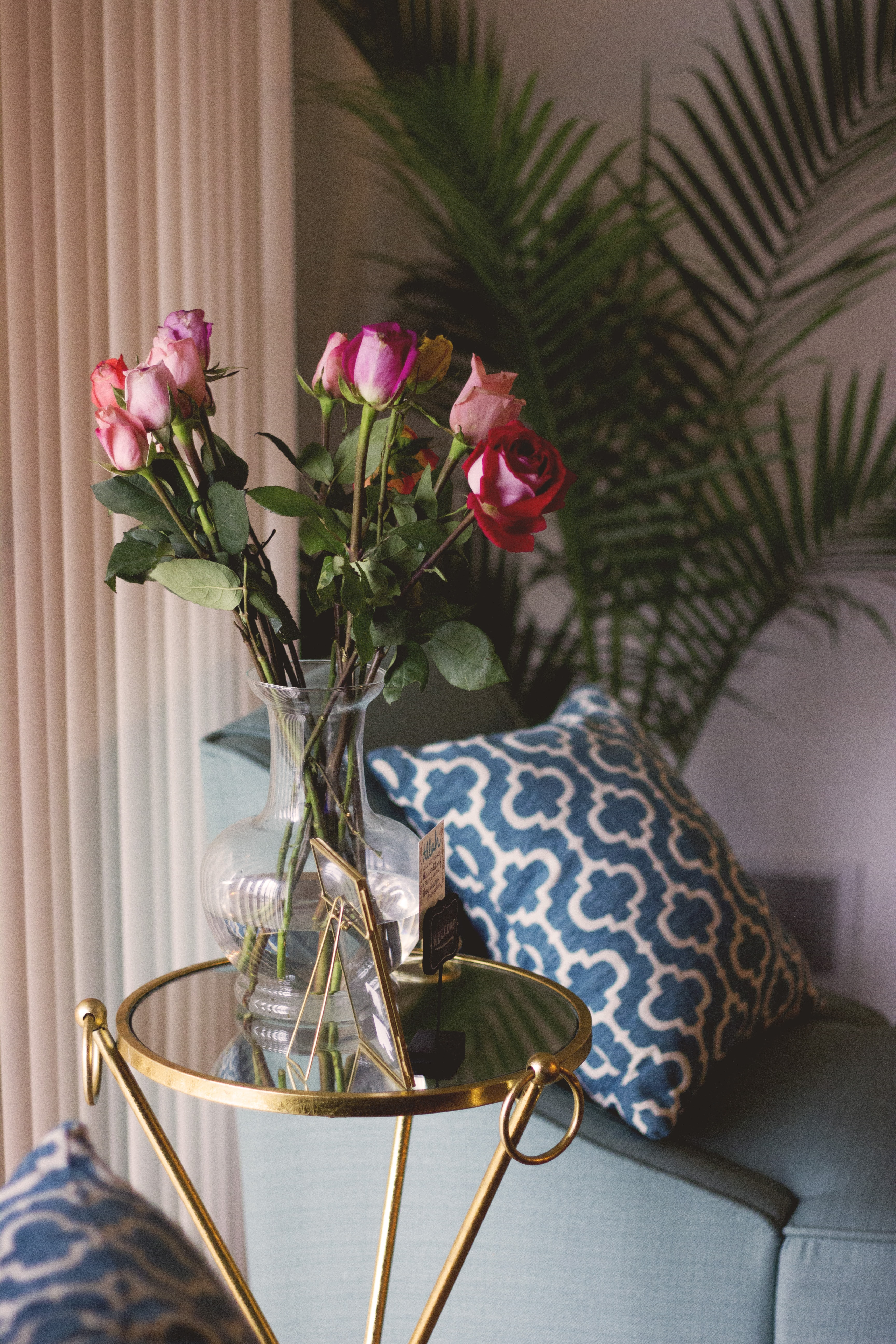 red and pink roses in clear glass vase