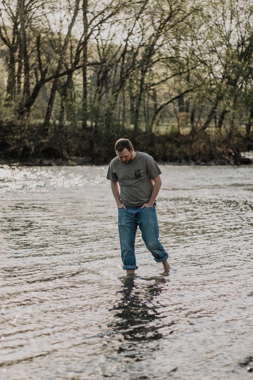 man walking in the lake at daytime