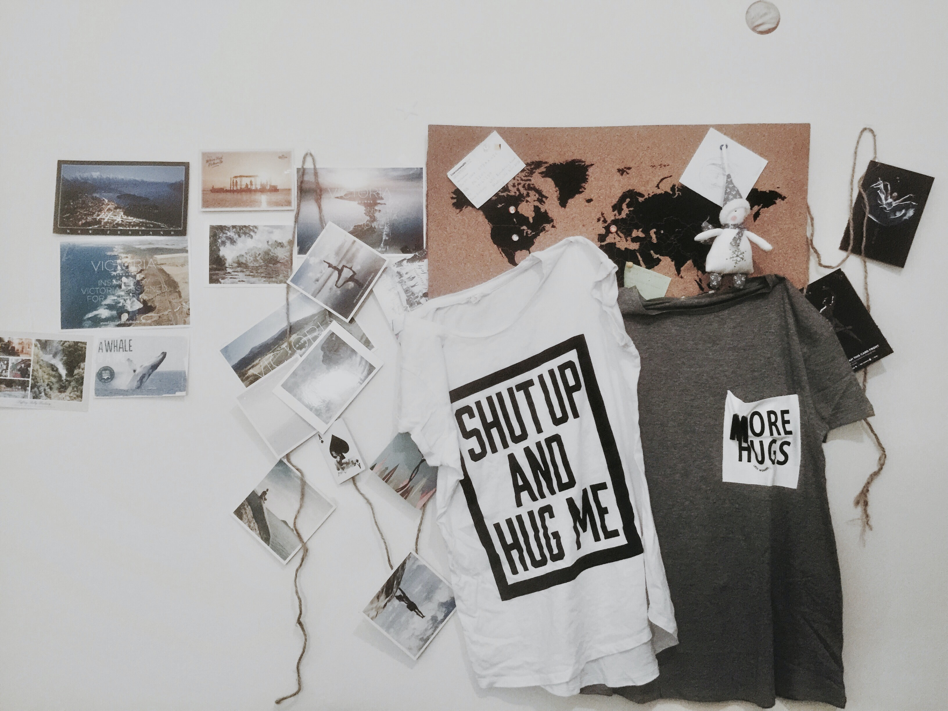 two white and gray text-printed hanging shirts