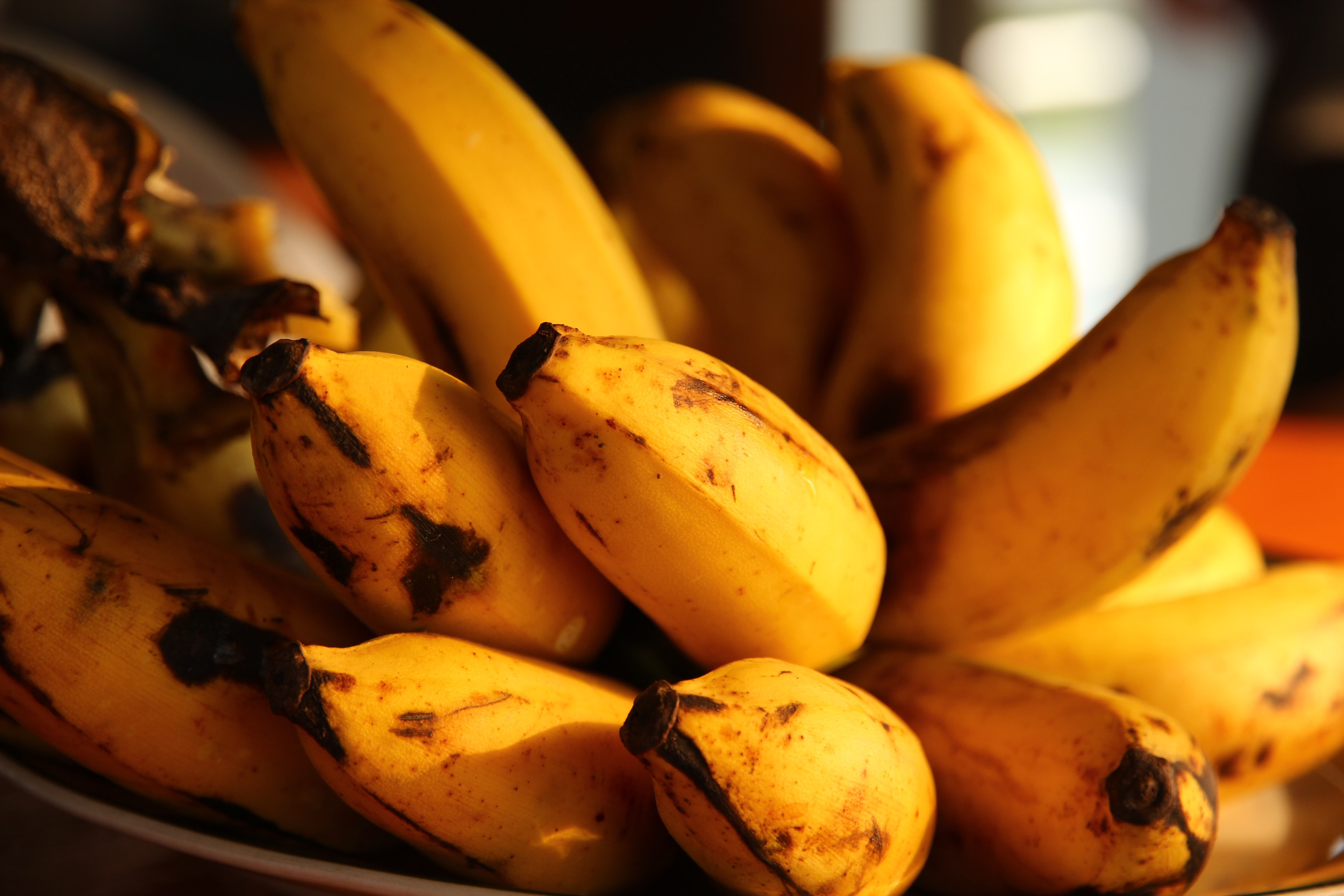 selective focus photography of ripped bananas