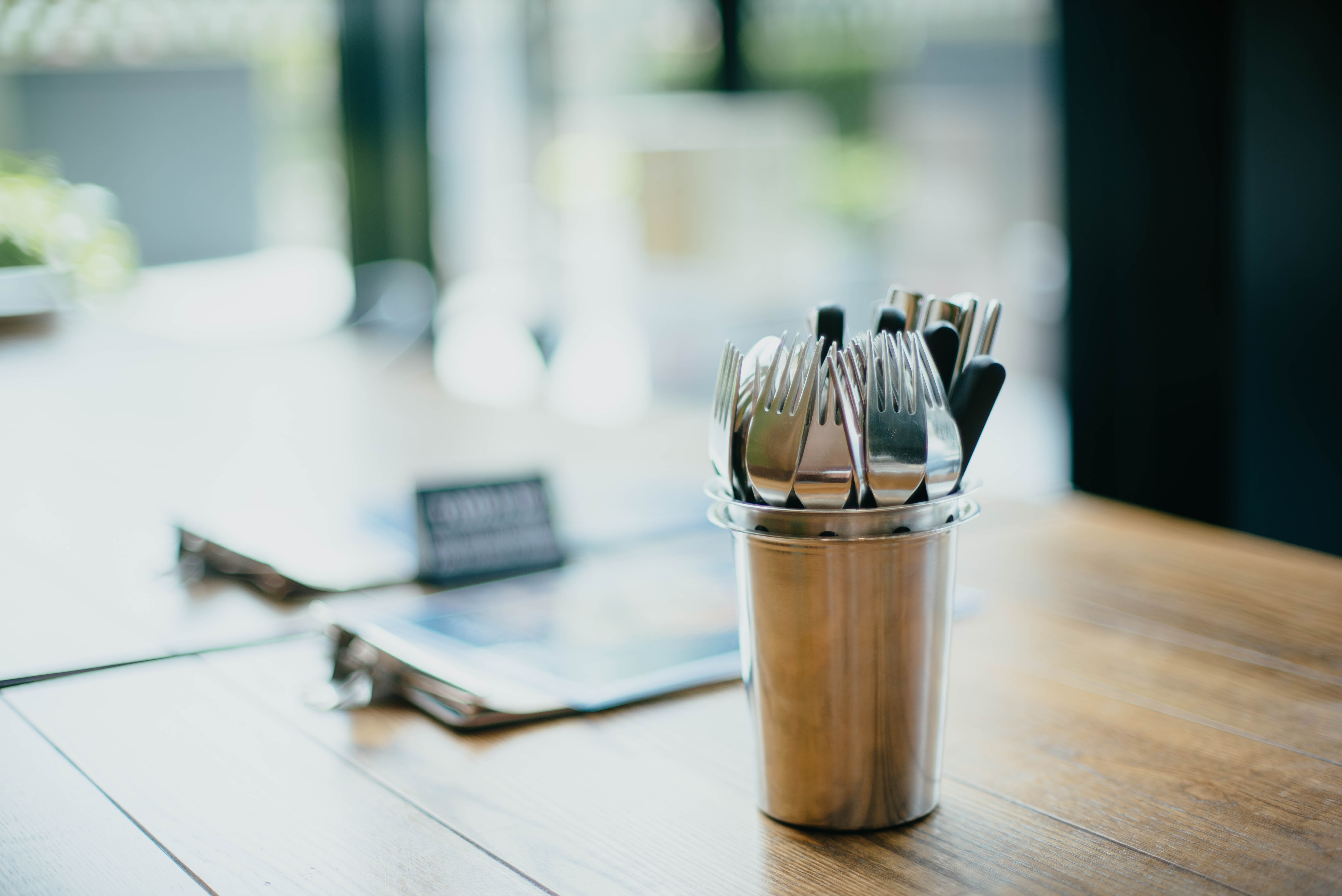 selective focus photography of cutlery on bucket