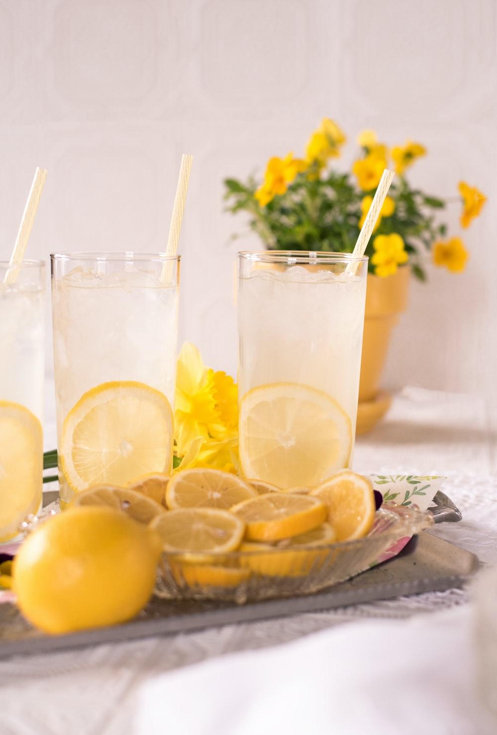 sliced lemon beside two clear drinking glasses