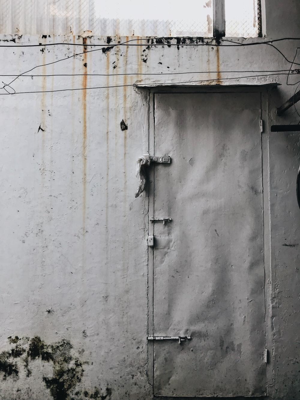 gray door and gray painted wall