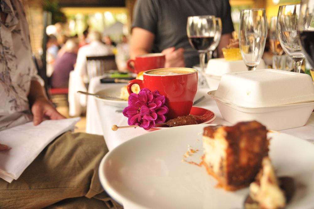 cappuccino inside red ceramic teacup