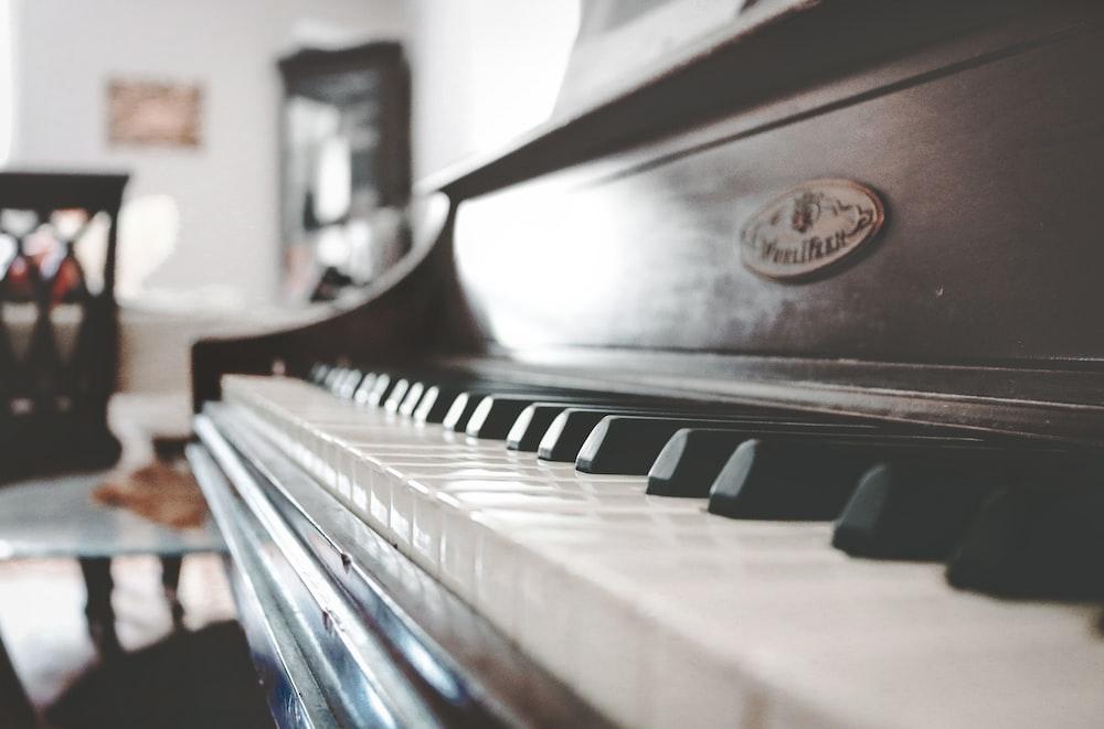 tilt shift focus photo of upright piano
