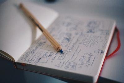 blue ballpoint pen on white notebook design zoom background