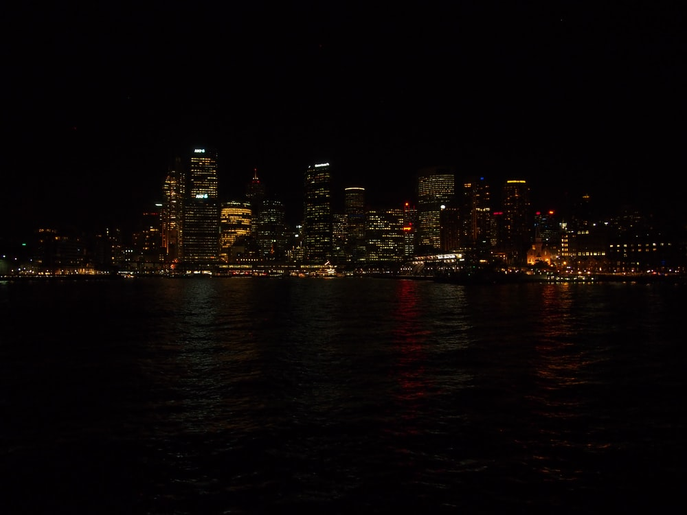 high-rise buildings near sea at nighttime