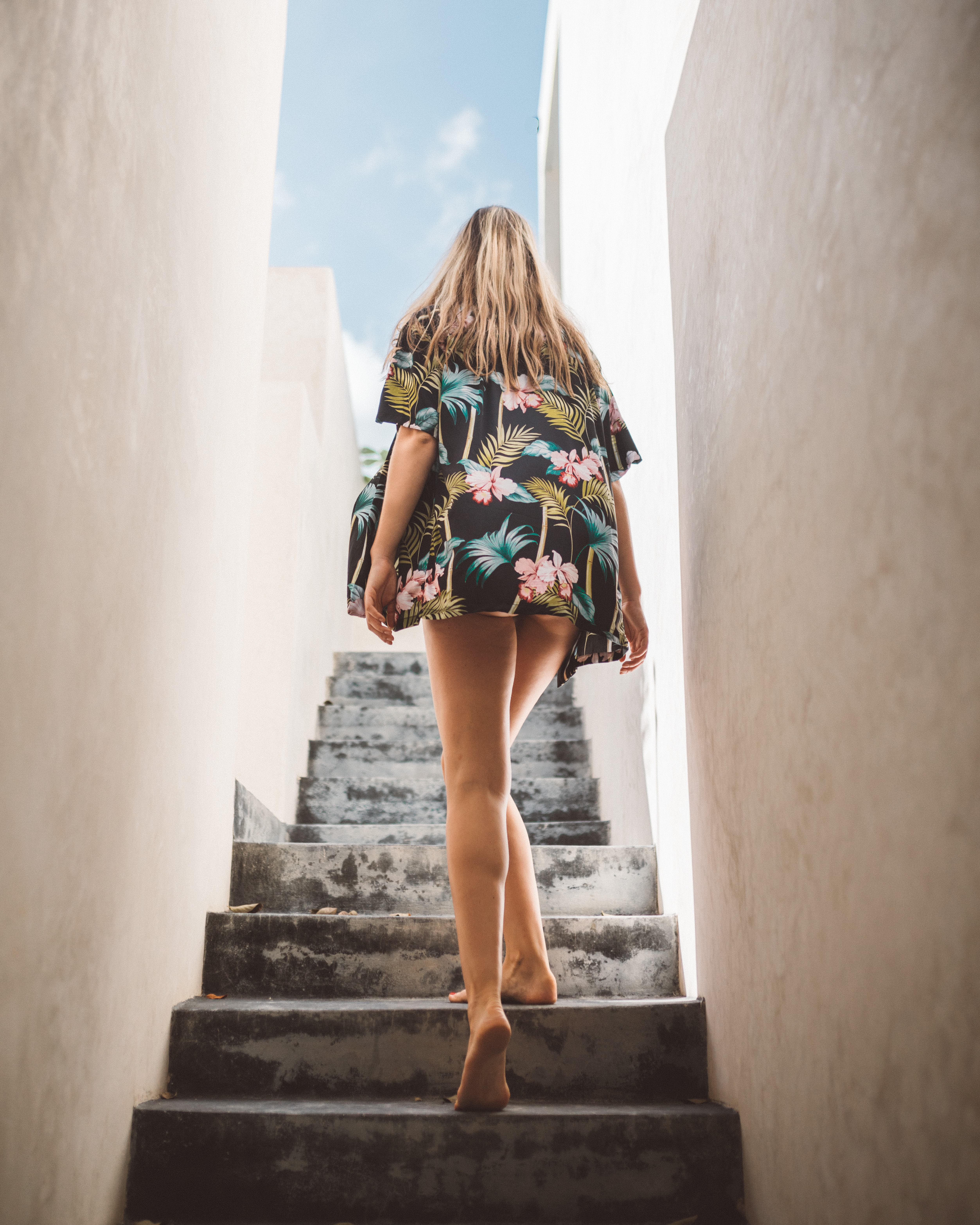 woman climbing on stair