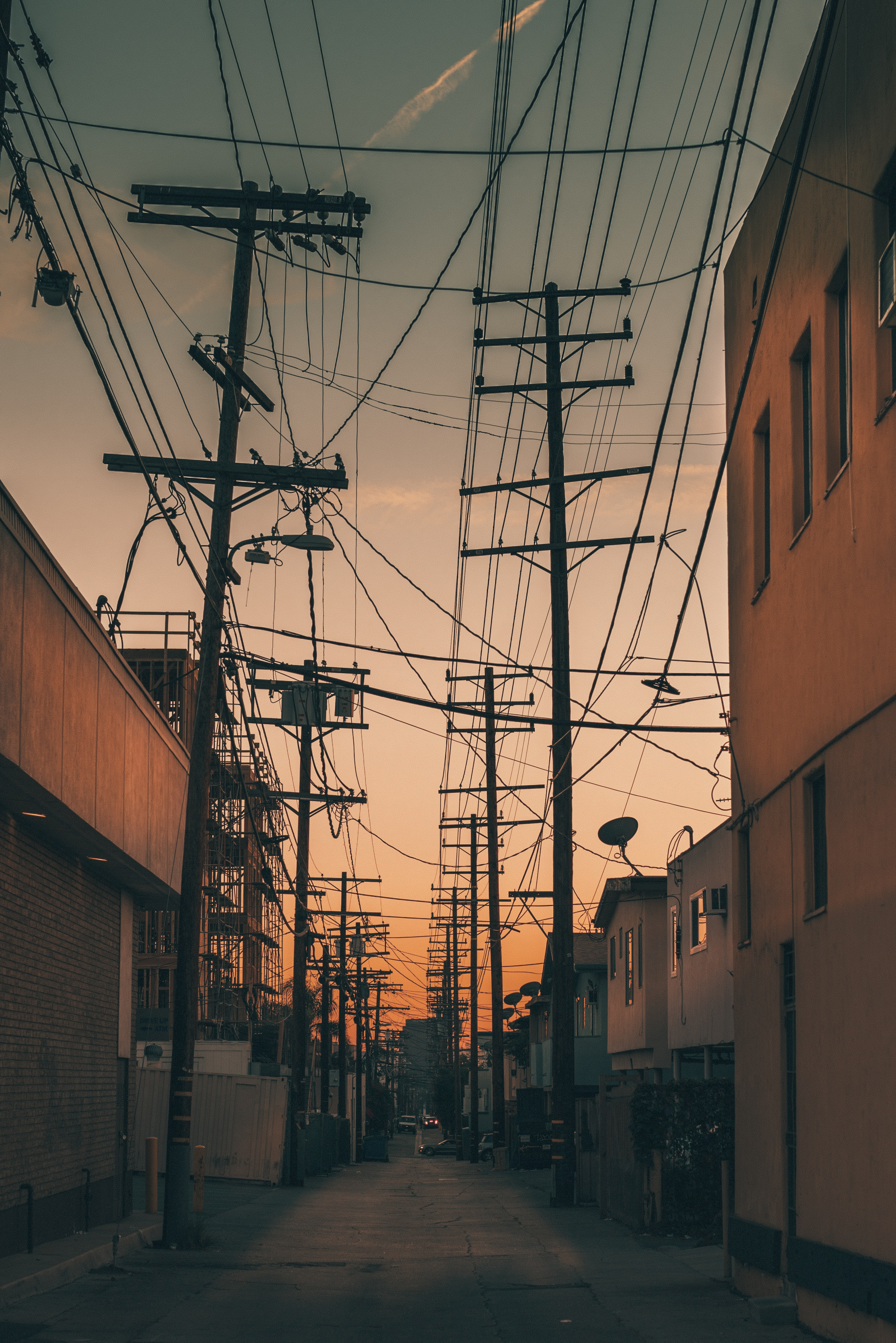 low angle photography of utility posts