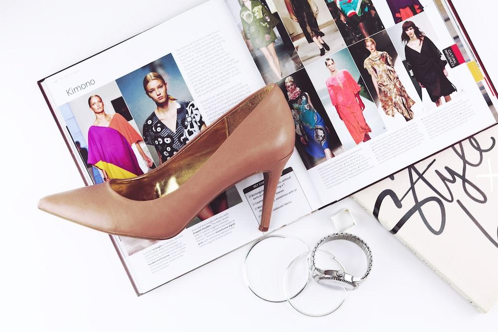 heeled sandal on top of magazine