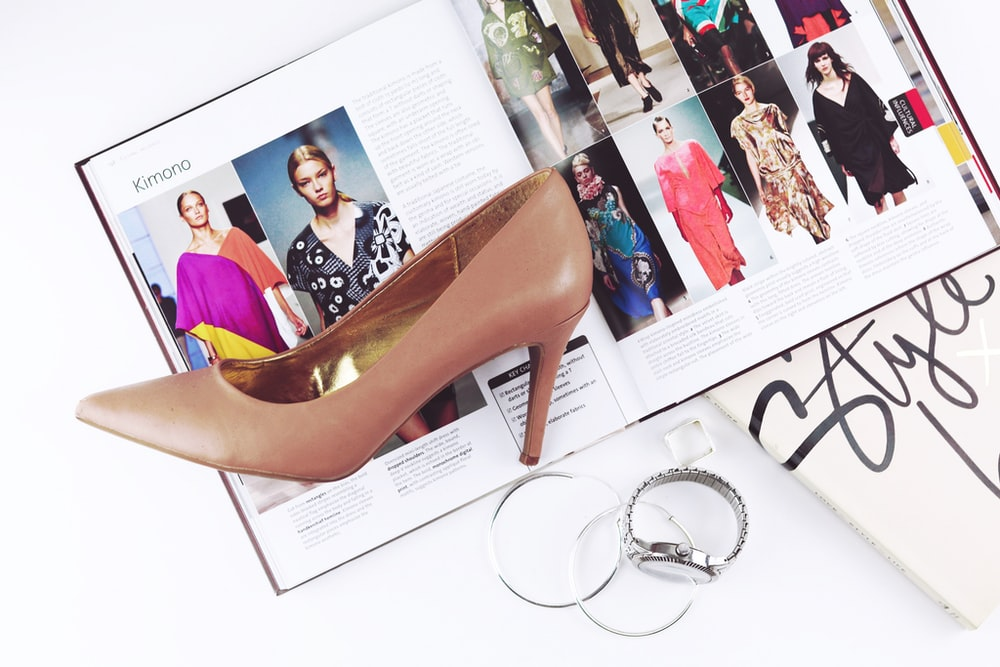 heeled sandal on top of magazine