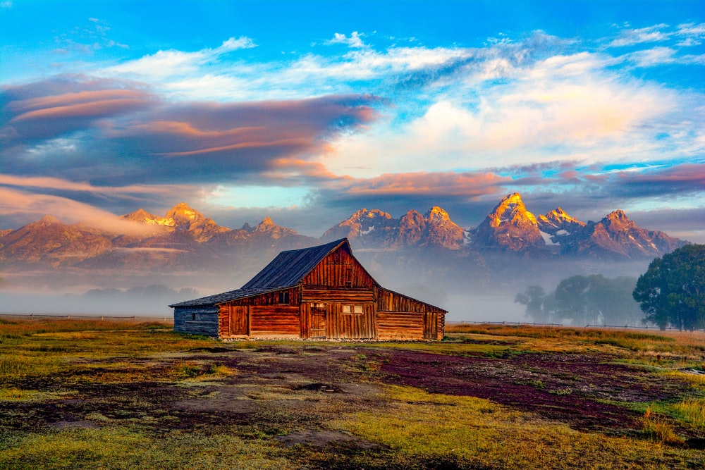 landscape photography of brown barn