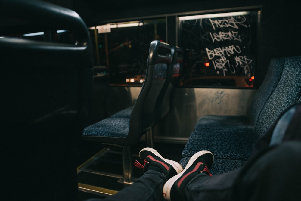photo of person sitting inside bus
