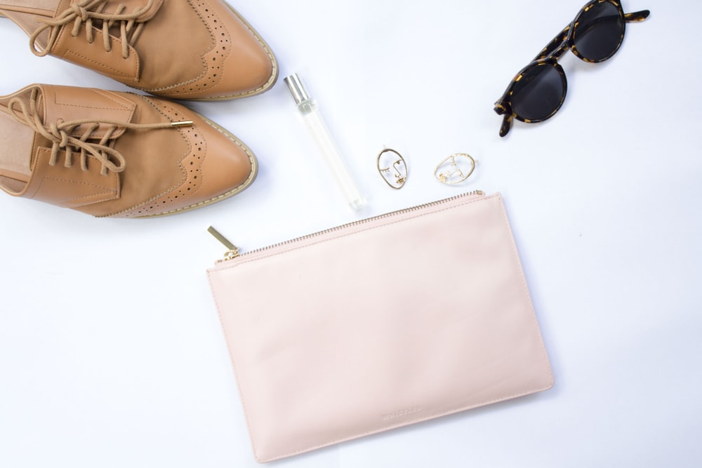 oxford shoes, sunglasses, and wristlet
