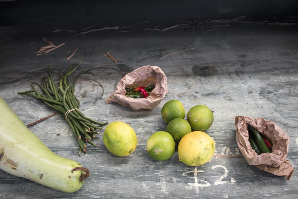 variety of vegetables on gray wooden surface