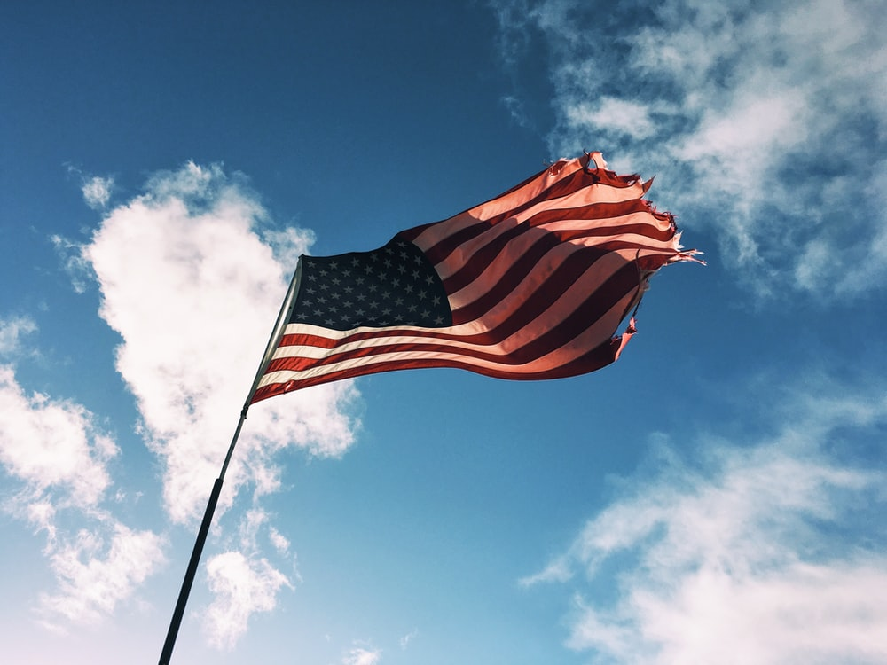 low angle of U.S.A flag on pole