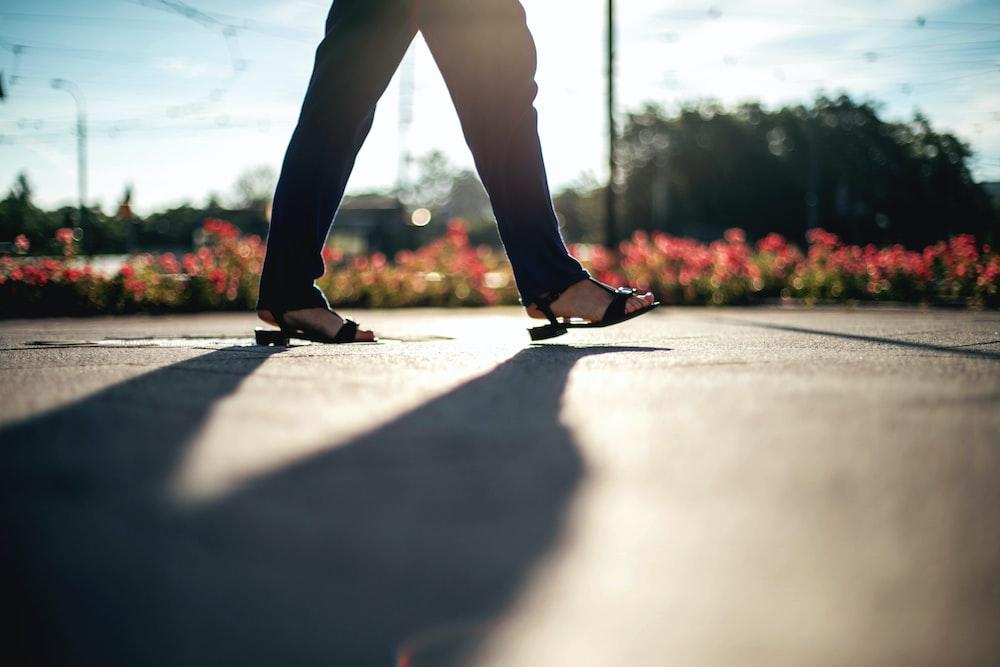 person walking on walkway during daytime