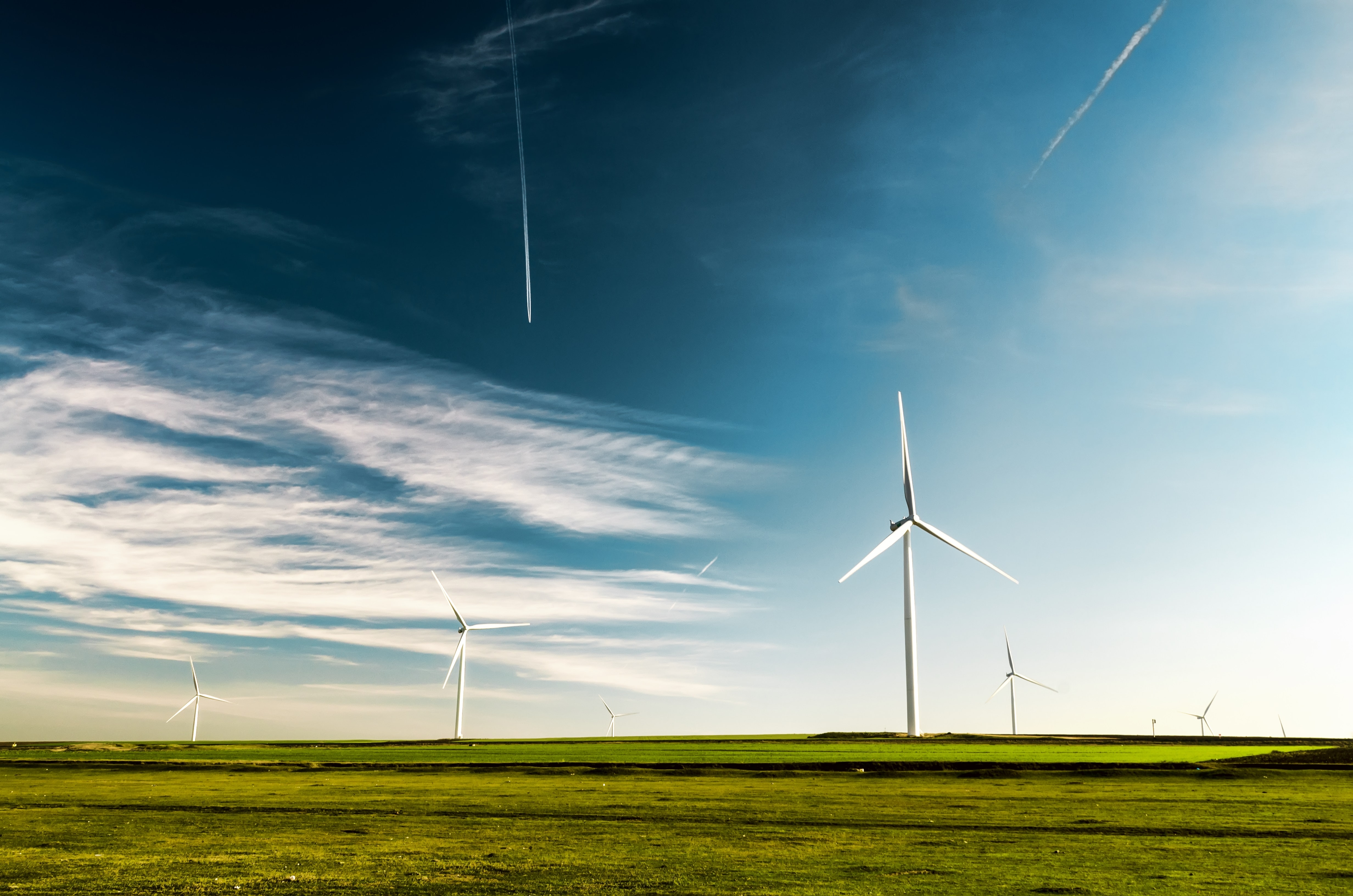 photo of wind turbines on green grass