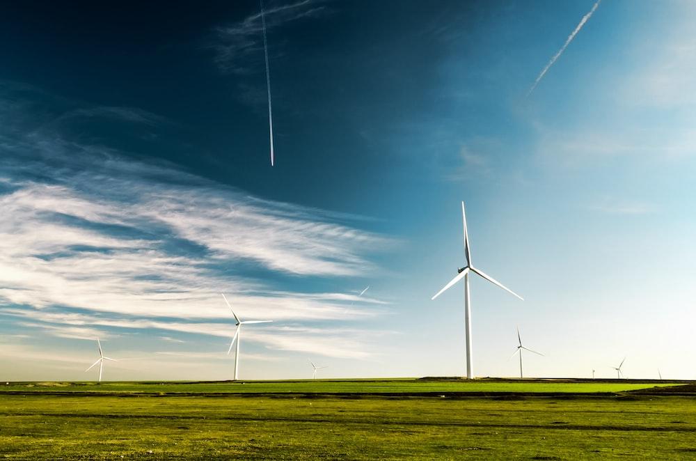 photo of wind turbines on green grass