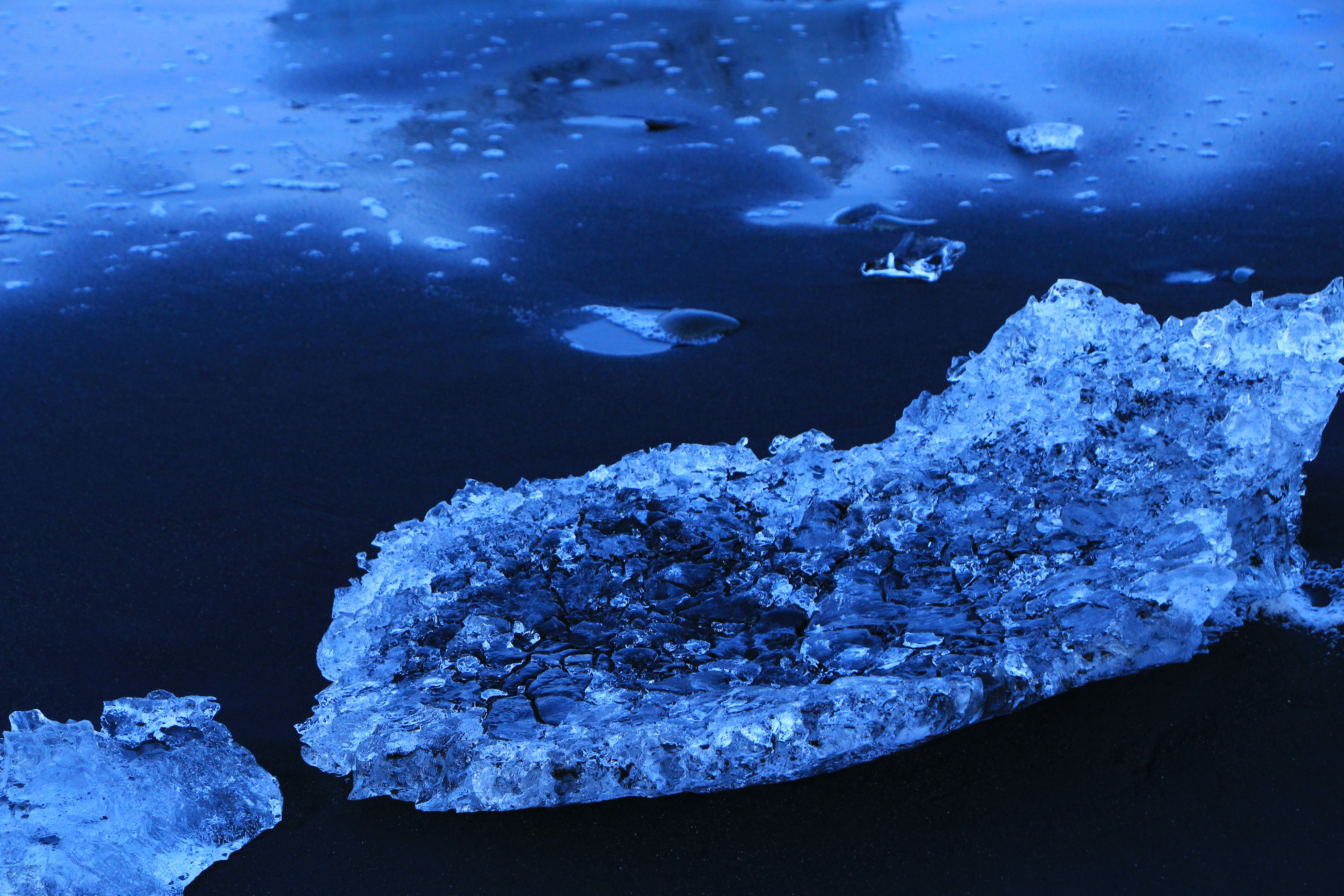 ice berg on body of water