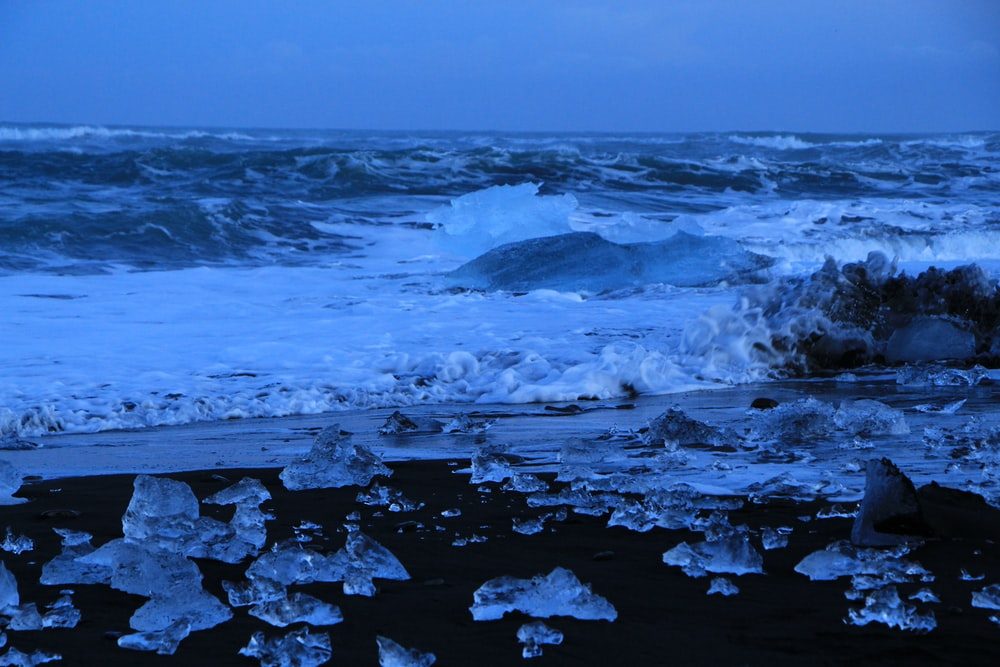 photograph of water rushing on shore