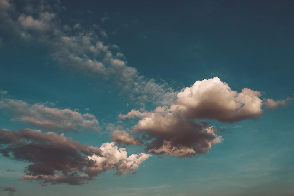 cumulus clouds under blue sky