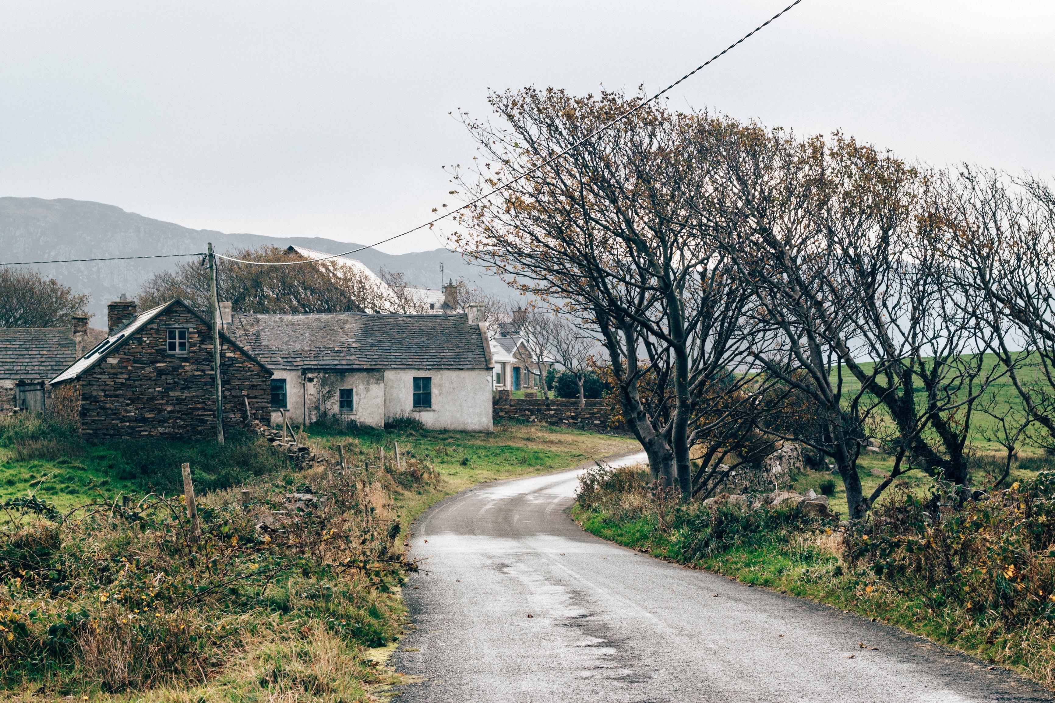 white concrete house beside road