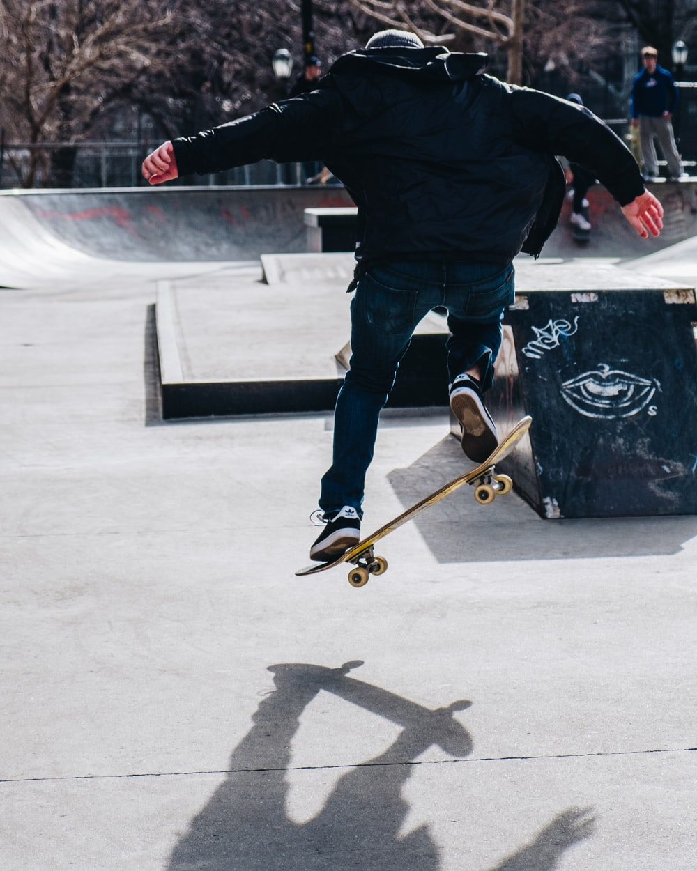 man riding on skateboard and performing tricks