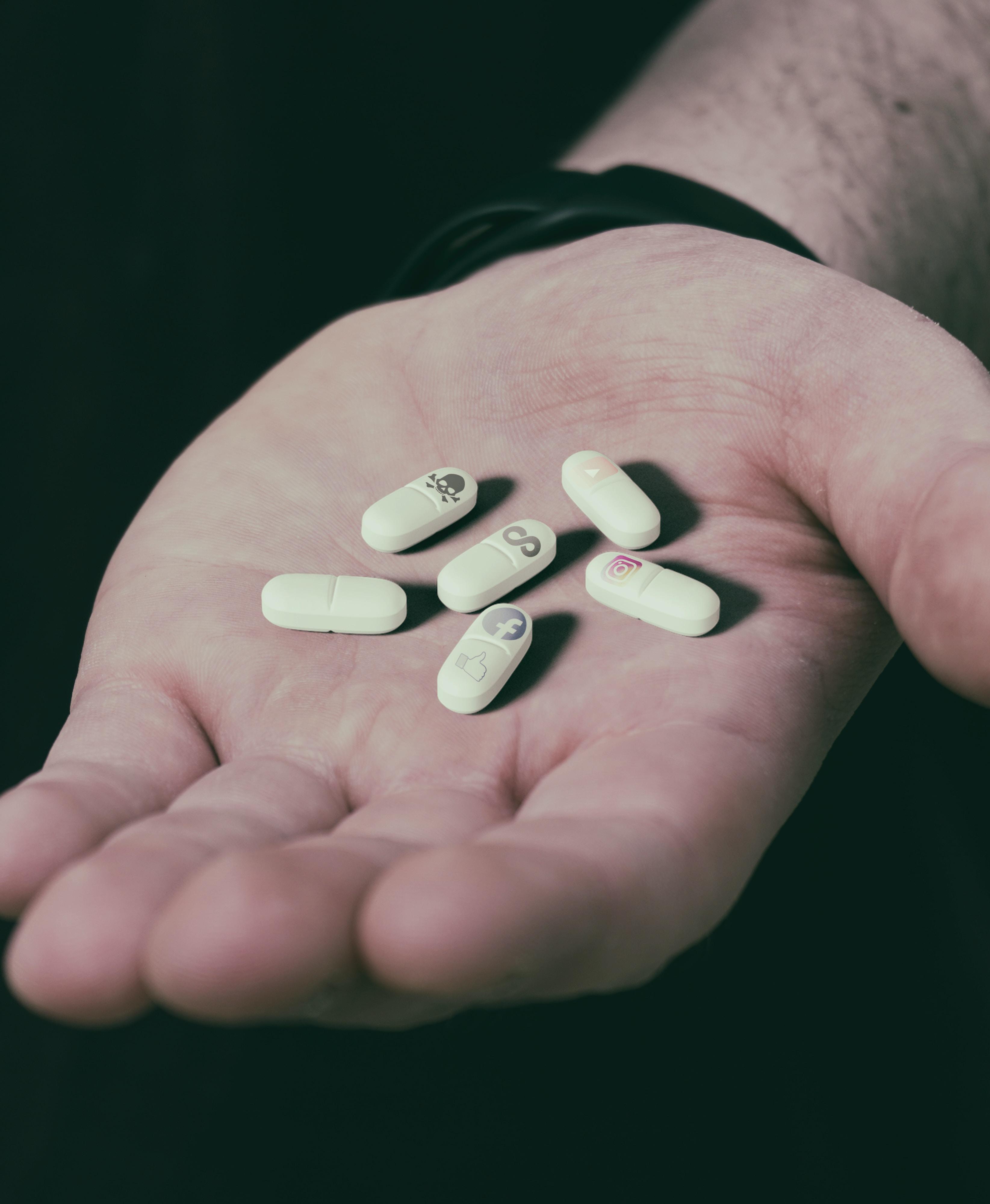 six white medication pills on hand
