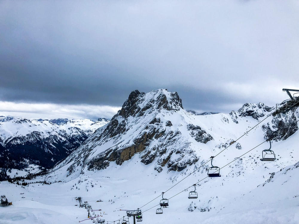 cable car on mountain ranges covered in snow