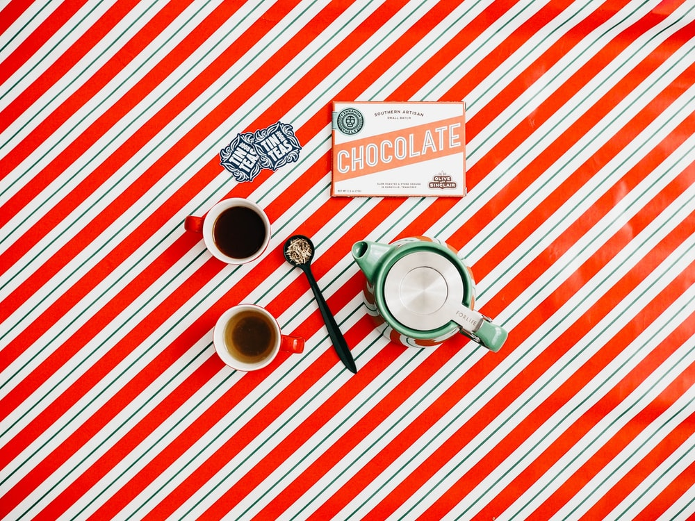 cup of coffee on red and white striped surface