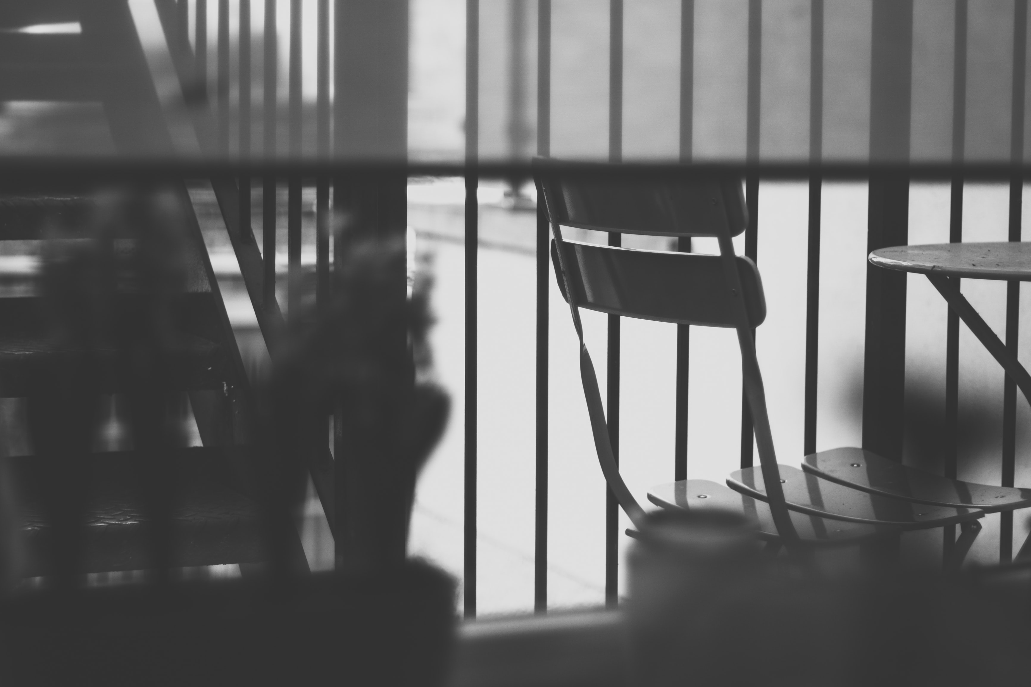 grayscale photography of metal chair