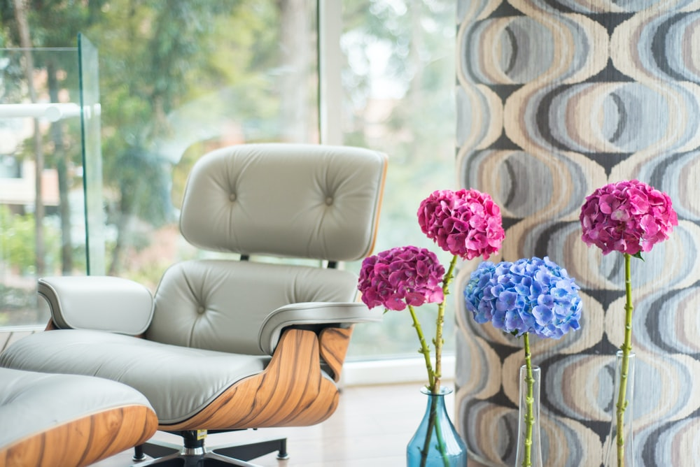 pink-and-blue flowers beside armchair