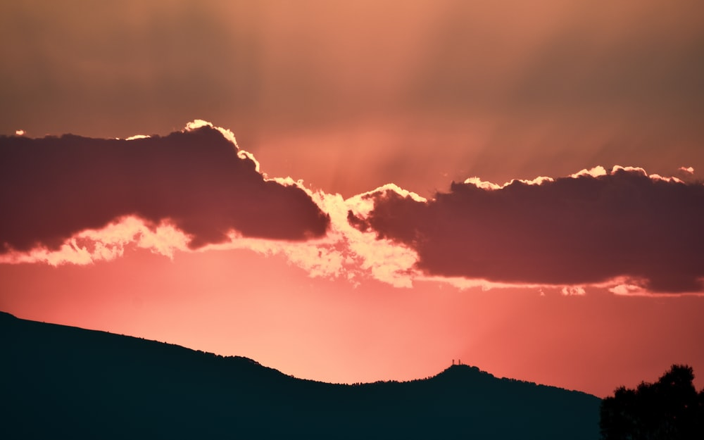 silhouette photo of mountain during golden hour