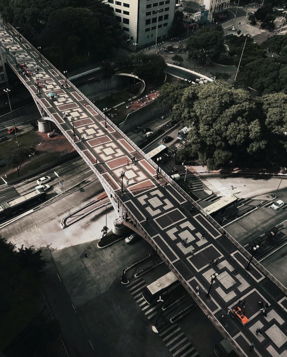 bird's eye view photography of a concrete bridge