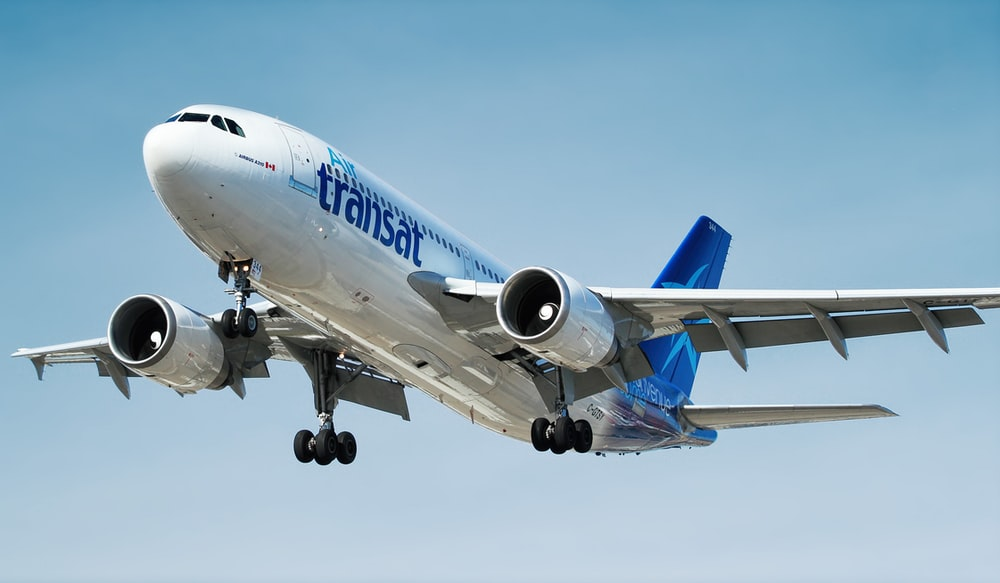 photo of gray and blue Transat airplane
